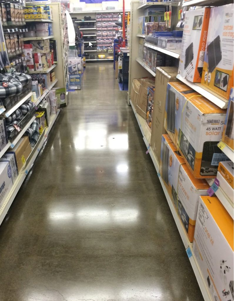 Maintenance of a concrete floor by doing apolish and seal